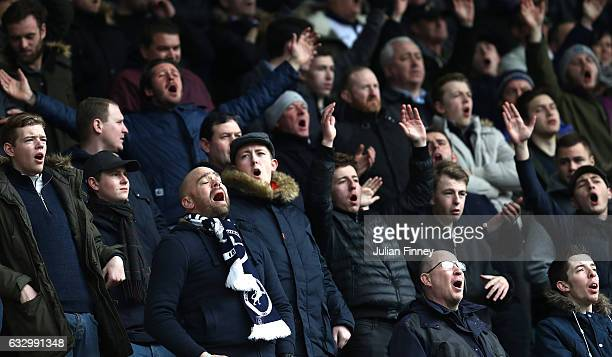 Millwall fans show their surport for their team during The Emirates FA Cup Fourth Round match between Millwall and Watford at The Den on January 29...