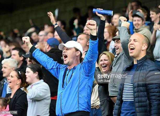 Millwall fans support celebrate during the Sky Bet Championship match between Millwall and Derby County at The Den on April 25 2015 in London England