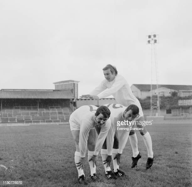 Millwall FC soccer players John Glichrist Brian Nichols and Keith Weller playing leapfrog London UK 8th July 1968