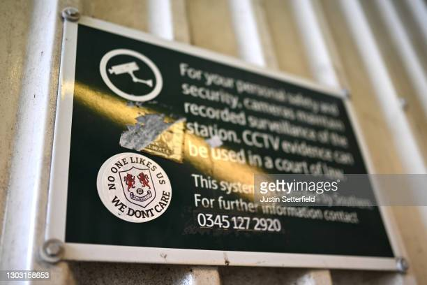 Millwall FC sticker is seen on a sign at a nearby station prior to the Sky Bet Championship match between Millwall and Wycombe Wanderers at The Den...