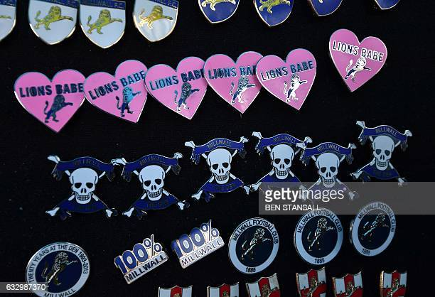 Millwall football club pin badges are seen ahead of the English FA Cup fourth round football match between Millwall and Watford at The Den in south...