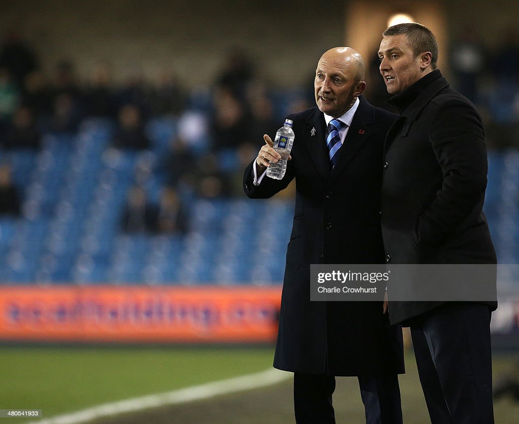 Millwall manager Ian Holloway chats with Birmingham manager Lee Clark during the Sky Bet Championship match between Millwall and Birmingham City at The Den on March 25, 2014 in London, England.