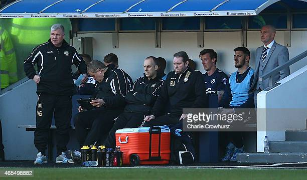 Millwall manager Ian Holloway hides away in the dug out during the Sky Bet Championship match between Millwall and Norwich City at The Den on March...
