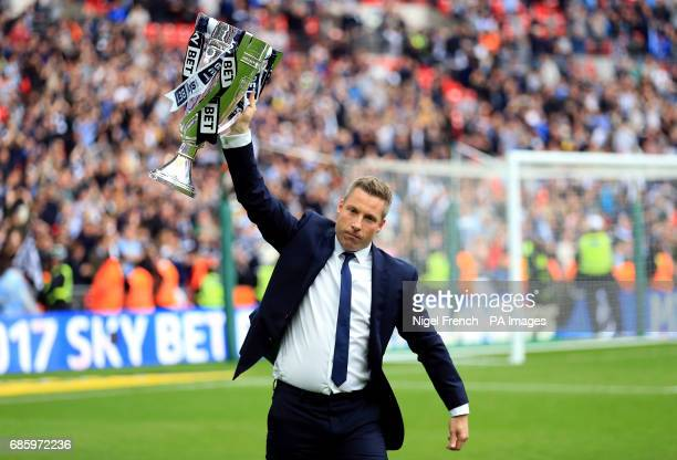 Millwall manager Neil Harris celebrates with the trophy after the Sky Bet League One play off final at Wembley Stadium London