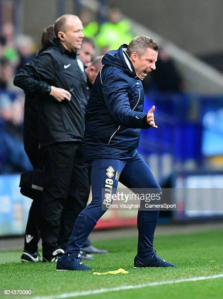Millwall manager Neil Harris shouts instructions to his team from the dugout during the Sky Bet League One match between Bolton Wanderers and...