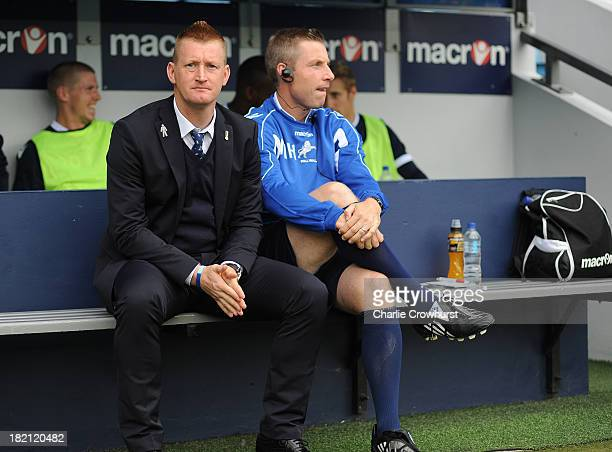 Millwall manager Steve Lomas with assistant coach Neil Harris during the Sky Bet Championship match between Millwall and Leeds United at The Den on...