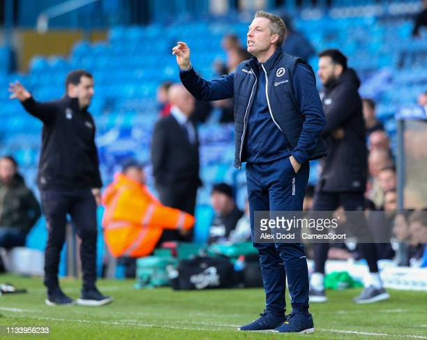 Millwall manager Neil Harris shouts instructions to his team from the technical area during the Sky Bet Championship match between Leeds United and...
