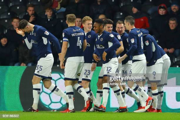 Millwall players celebrate scoring a goal during the Sky Bet Championship match between Hull City and Millwall FC at KCOM Stadium on March 6 2018 in...