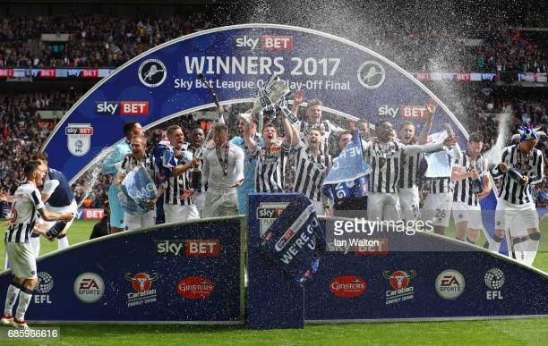 Millwall players celebrate victory and promotion with the trophy after the Sky Bet League One Playoff Final between Bradford City and Millwall at...