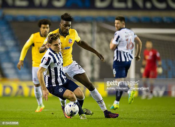 Millwall's Ben Thompson holds off the challenge from Bolton Wanderers' Sammy Ameobi during the Sky Bet League One match between Millwall and Bolton...