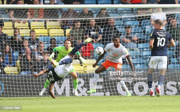 Millwall's Benik Afobe with an overhead kick in the first half during the Sky Bet Championship match between Millwall and Blackpool at The Den on...