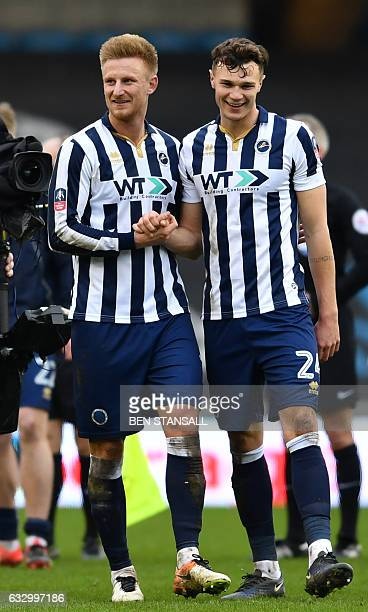 Millwall's English defender Byron Webster and Millwall's English defender Jake Cooper celebrate on the pitch after the English FA Cup fourth round...