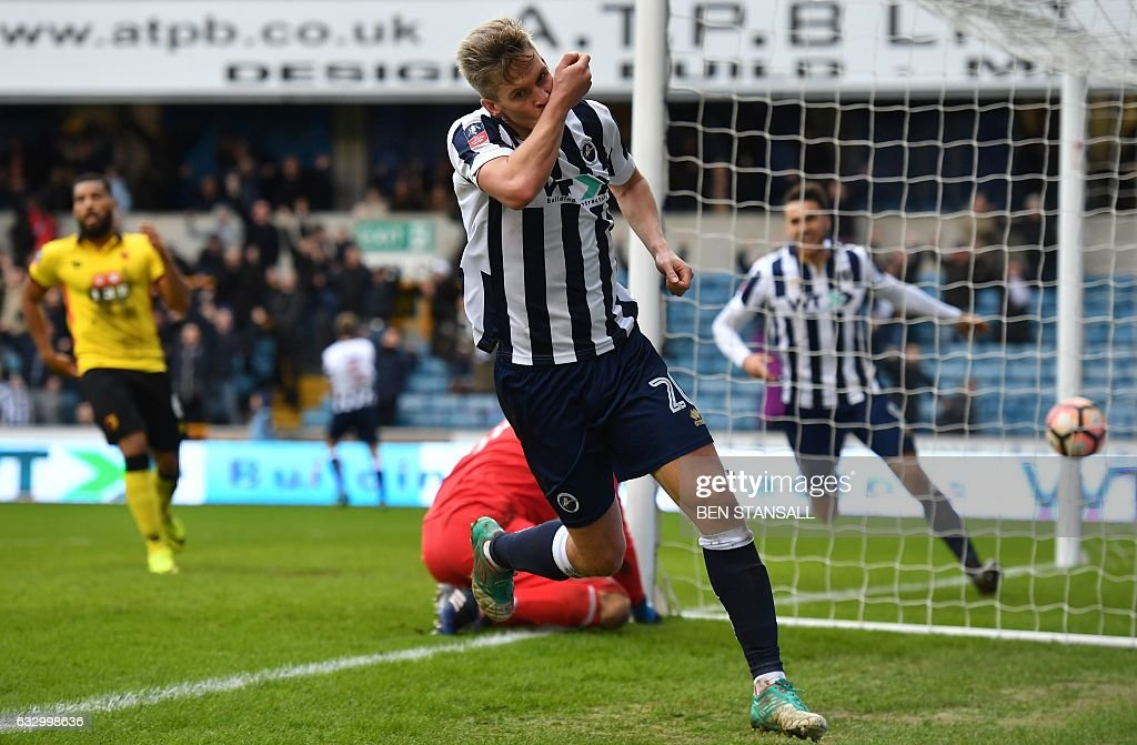 Millwall's English-born Welsh striker Steve Morison (C) celebrates after scoring the opening goal of the English FA Cup fourth round football match between Millwall and Watford at The Den in south London on January 29, 2017. / AFP / Ben STANSALL / RESTRICTED TO EDITORIAL USE. No use with unauthorized audio, video, data, fixture lists, club/league logos or 'live' services. Online in-match use limited to 75 images, no video emulation. No use in betting, games or single club/league/player publications. /