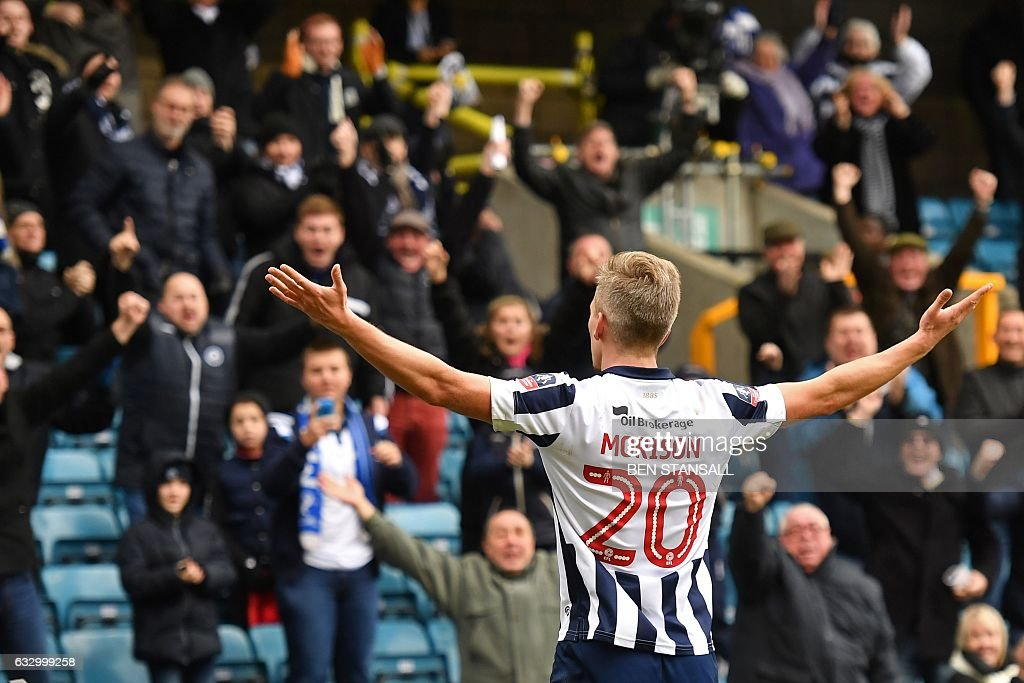 Millwall's English-born Welsh striker Steve Morison celebrates after scoring the opening goal of the English FA Cup fourth round football match between Millwall and Watford at The Den in south London on January 29, 2017. / AFP / Ben STANSALL / RESTRICTED TO EDITORIAL USE. No use with unauthorized audio, video, data, fixture lists, club/league logos or 'live' services. Online in-match use limited to 75 images, no video emulation. No use in betting, games or single club/league/player publications. /
