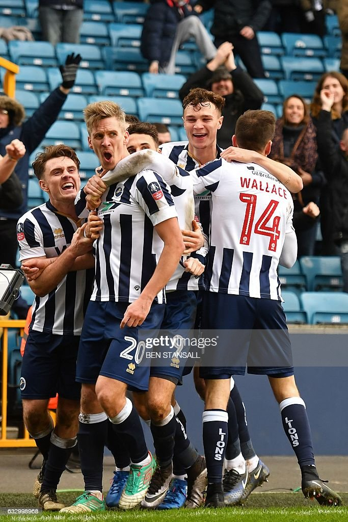 Millwall's English-born Welsh striker Steve Morison (2nd L) celebrates with teammates after scoring the opening goal of the English FA Cup fourth round football match between Millwall and Watford at The Den in south London on January 29, 2017. / AFP / Ben STANSALL / RESTRICTED TO EDITORIAL USE. No use with unauthorized audio, video, data, fixture lists, club/league logos or 'live' services. Online in-match use limited to 75 images, no video emulation. No use in betting, games or single club/league/player publications. /