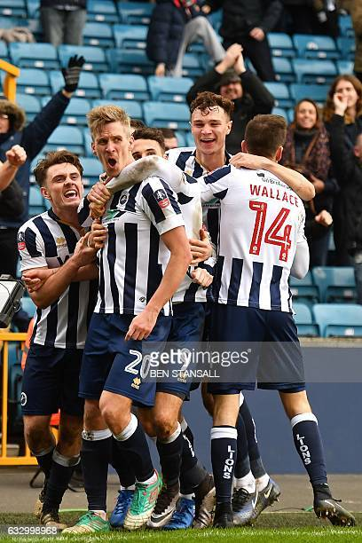 Millwall's Englishborn Welsh striker Steve Morison celebrates with teammates after scoring the opening goal of the English FA Cup fourth round...