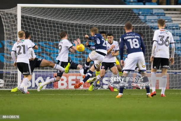 Millwall's George Saville has a shot at goal during the Sky Bet Championship match between Millwall and Sheffield United at The Den on December 2...