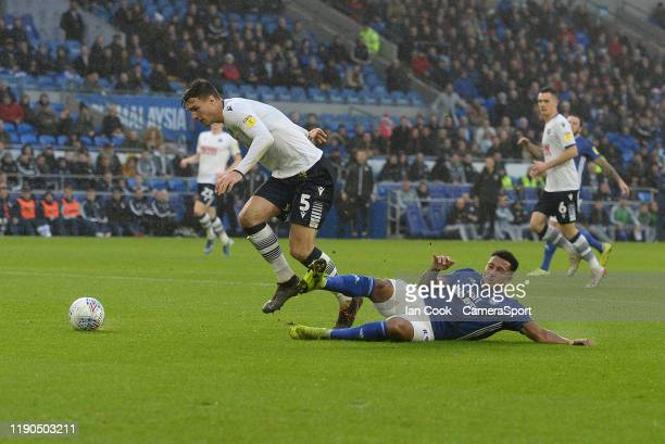 CARDIFF WALES DECEMBER Millwall's Jake Cooper and Cardiff City's Nathaniel MendezLaing collide during the Sky Bet Championship match between Cardiff...