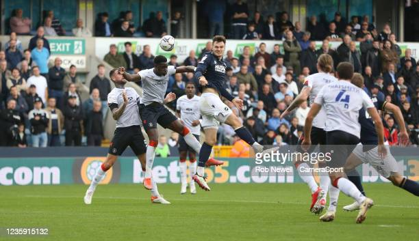 Millwall's Jake Cooper with a header in the first half during the Sky Bet Championship match between Millwall and Luton Town at The Den on October...