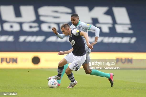 Millwall's Jed Wallace and Blackburn Rovers' Tosin Adarabioyo during the Sky Bet Championship match between Millwall and Blackburn Rovers at The Den...