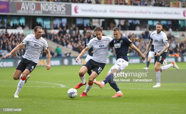 Millwall's Jed Wallace with a first half shot during the Sky Bet Championship match between Millwall and Luton Town at The Den on October 16, 2021 in...