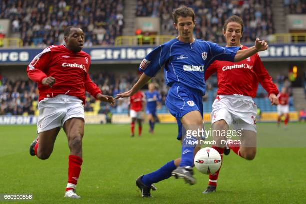 Millwall's Mark Phillips is closed down by Nottingham Forest's Andrew Impey and Eoin Jess
