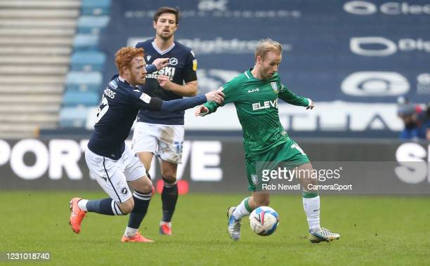 Millwall's Ryan Woods and Sheffield Wednesday's Barry Bannan during the Sky Bet Championship match between Millwall and Sheffield Wednesday at The...