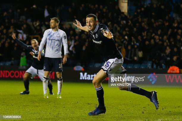 Millwall's Scottish defender Murray Wallace celebrates scoring their third goal to take the lead 32 during the English FA Cup fourth round football...