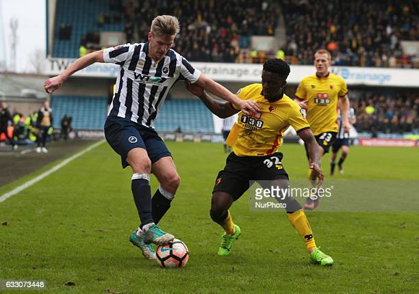 Millwall's Steve Morison holds of Watford's Brandon Mason during The Emirates FA Cup Fourth Round match between Millwall against Watford at The Den...