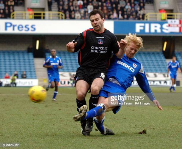 Millwall's Zak Whitbread beats Crystal Palace's Dougie Freedman to the ball during the CocaCola Championship match at the New Den Millwall Saturday...