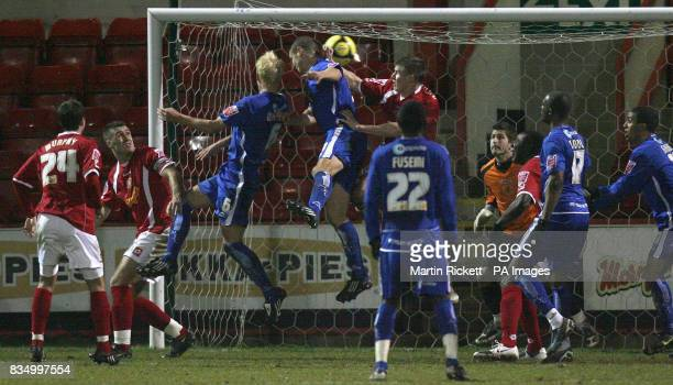 Millwall's Zak Whitbread scoring his team's third goal during the FA Cup Third Round Replay at Gresty Road Crewe