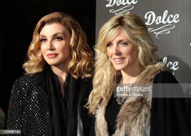 Milly Carlucci and Marla Maples attend the Dolce store opening on November 14 2011 in Rome Italy