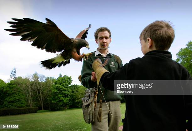 Milo Kremer with instructor Mike Coles at the falconry center at Gleneagles Hotel in Perthshire Scotland Sunday May 29 2005 With an extensive menu of...