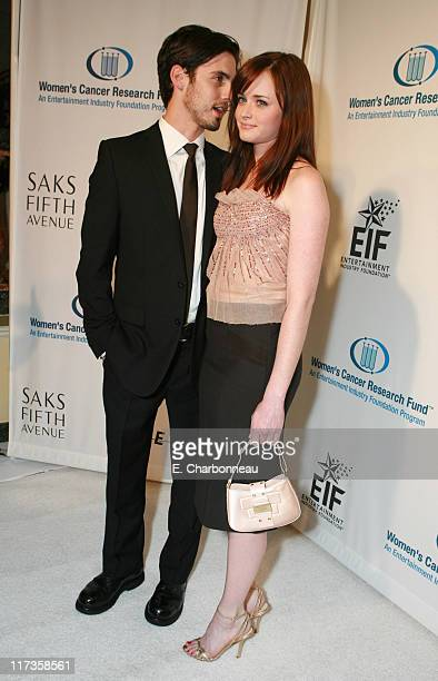Milo Ventimiglia and Alexis Bledel during Saks Fifth Avenue's Unforgettable Evening Benefitting EIF's Women's Cancer Research Fund Red Carpet at...