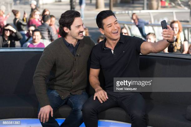 Milo Ventimiglia and Mario Lopez take a selfie together at 'Extra' at Universal Studios Hollywood on December 4 2017 in Universal City California