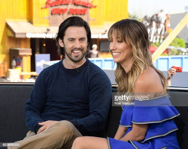 Milo Ventimiglia and Renee Bargh visit 'Extra' at Universal Studios Hollywood on March 15 2017 in Universal City California