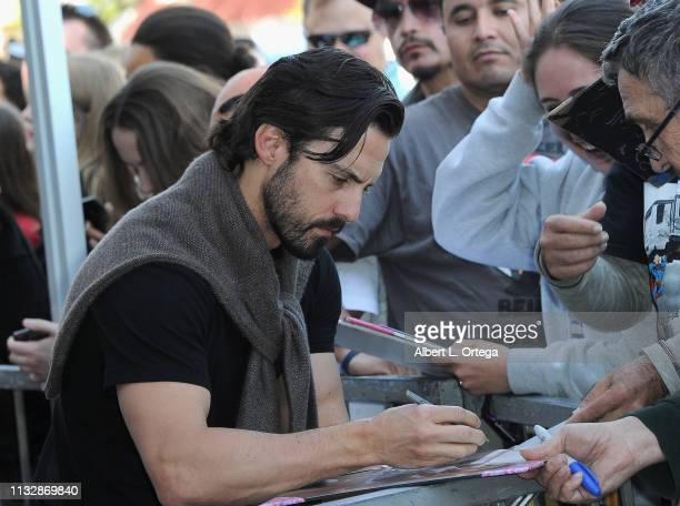 Milo Ventimiglia signs autographs at Mandy Moore's Star Ceremony on the Hollywood Walk of Fame on March 25 2019 in Hollywood California