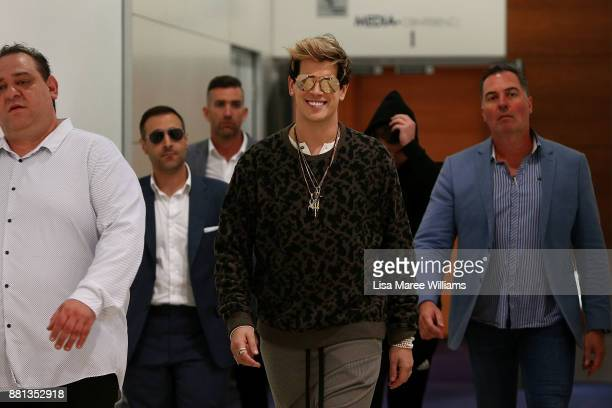 Milo Yiannopoulos arrives at the Sydney International Airport on November 29 2017 in Sydney Australia Yiannopoulos is in Australia for his Troll...