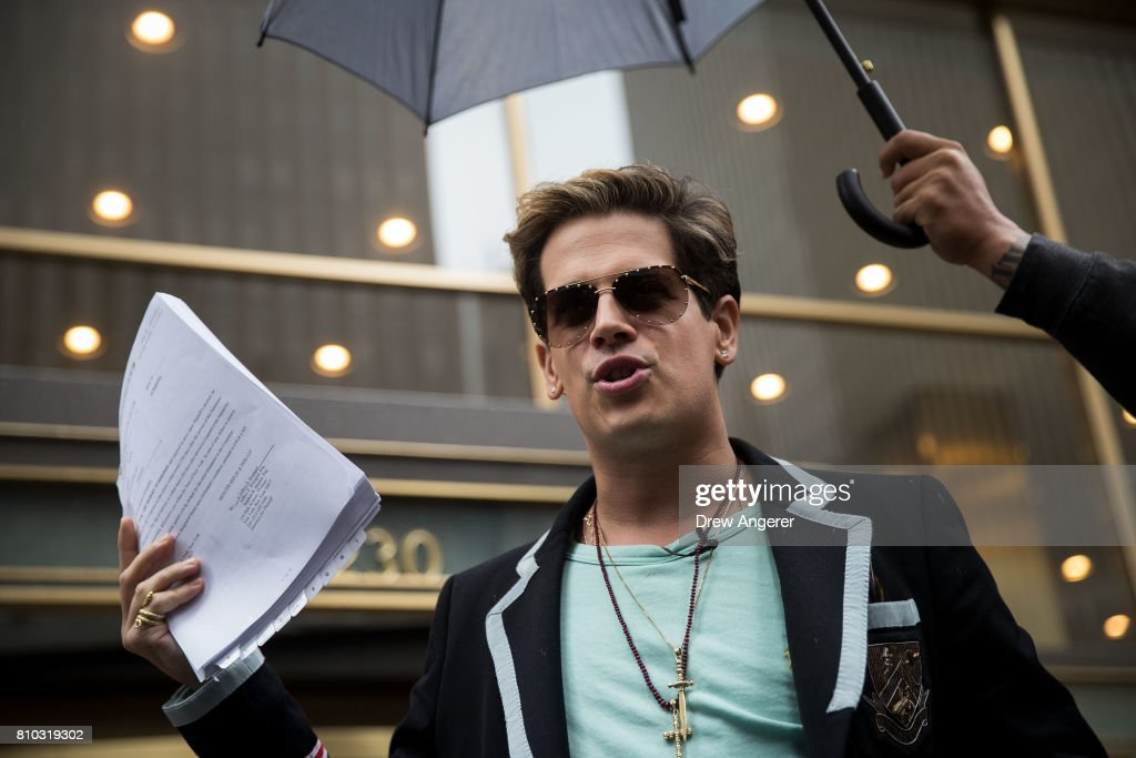 Milo Yiannopoulos holds up a copy of a legal complaint as he speaks outside the offices of Simon & Schuster publishing company, July 7, 2017 in New York City. Yiannopoulos is promoting a new book and filing a $10 million legal complaint against Simon & Schuster following the publisher's decision to cancel his book deal.