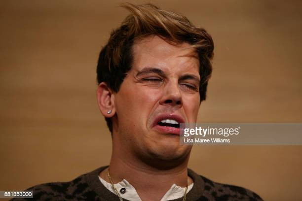 Milo Yiannopoulos reacts during a press conference on arrival at the Sydney International Airport on November 29 2017 in Sydney Australia...