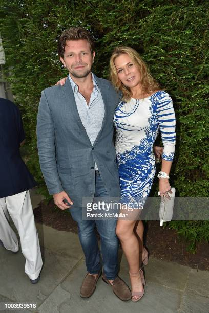 Milos Alacalay and Erin Gibbs attend the LongHouse Reserve Annual Benefit Celebrates Brooklyn at LongHouse Reserve on July 21 2018 in East Hampton...