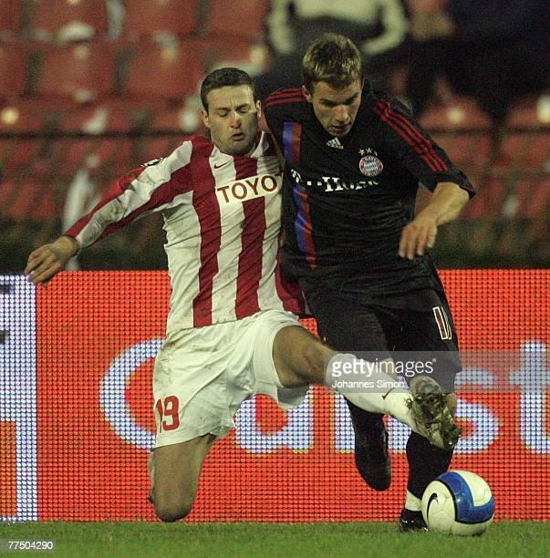 Milos Bajalica of Belgrade and Lukas Podolski of Bayern in action during the UEFA Cup group F match between Crvena Zvezda and Bayern Munich at Crvena...
