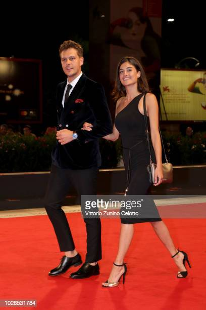 Milos Bikovic and guest walk the red carpet ahead of the Dragged Across Concrete screening during the 75th Venice Film Festival at Sala Grande on...