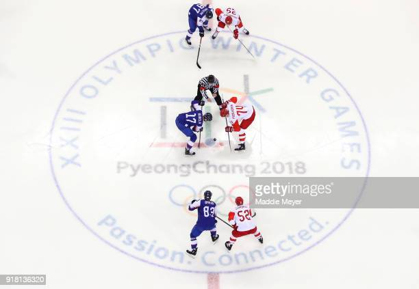 Milos Bubela of Slovakia and Nikolai Prokhorkin of Olympic Athlete from Russia face off in the first period during the Men's Ice Hockey Preliminary...