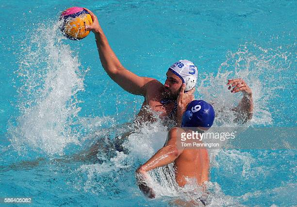 Milos Cuk of Serbia controls the ball against Daniel Varga of Hungary during the Men's Water Polo Preliminary Round Group A match between Serbia and...