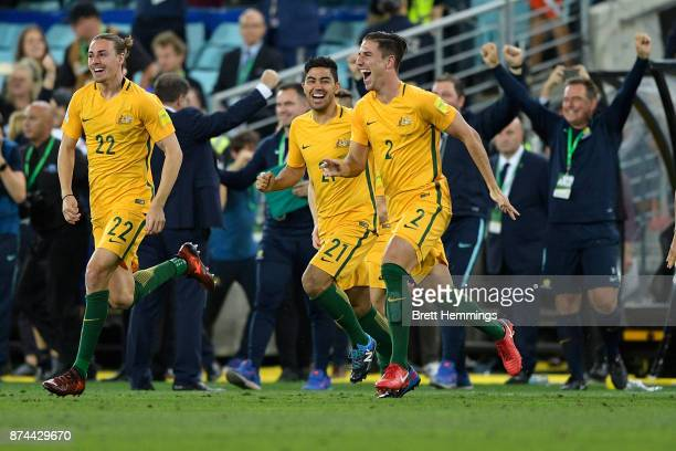 Milos Degenek Jackson Irvine and Massimo Luongo of Australia celebrate victory during the 2018 FIFA World Cup Qualifiers Leg 2 match between the...