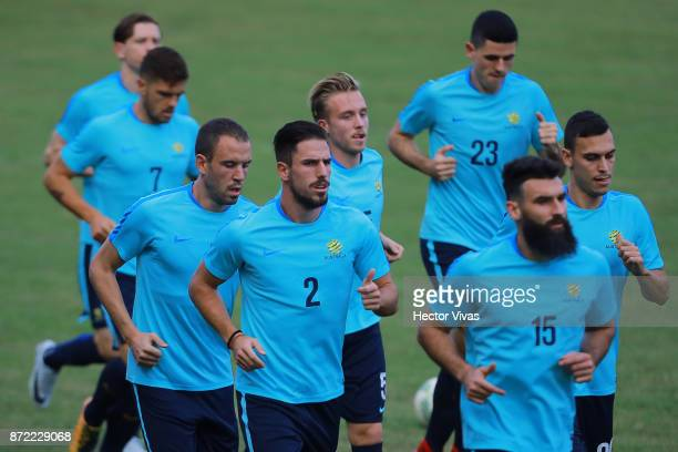 Milos Degenek Mile Jedinak of Australia and teammates run during a training session ahead of the leg 1 of FIFA World Cup Qualifier Playoff against...