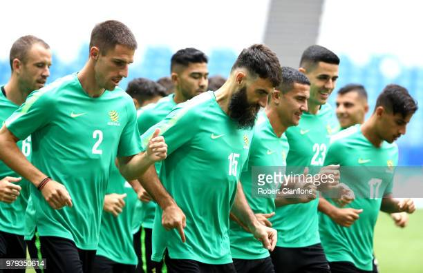 Milos Degenek Mile Jedinak Tim Cahill Tom Rogic and Daniel Arzani of Australia warm up during an Australia Socceroos training session ahead of the...