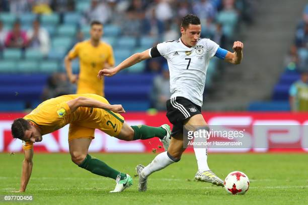 Milos Degenek of Australia and Julian Draxler of Germany battle for possession during the FIFA Confederations Cup Russia 2017 Group B match between...