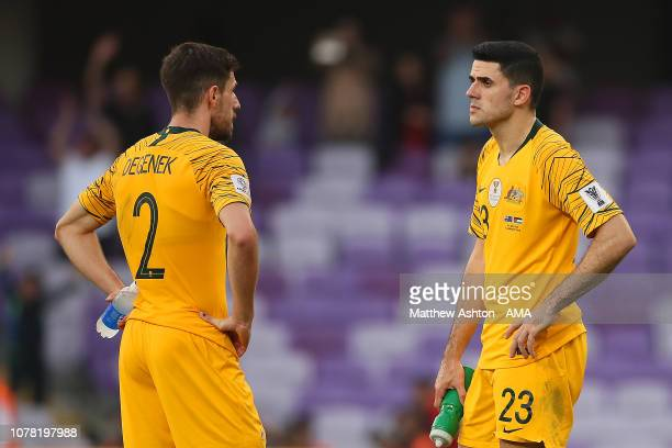 Milos Degenek of Australia and Tom Rogic of Australia look dejected at the end of the AFC Asian Cup Group B match between Australia and Jordan at...